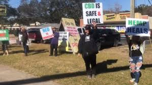 Florida Protesters rally behind Pensacola shop owner, saying CBD shipment was legal